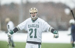 Brett Martin cheers after the Eagles netted a goal. The senior midfielder earned one assist in Wednesday's 11-2 loss to the Lasers. Image by: athletics.husson.edu